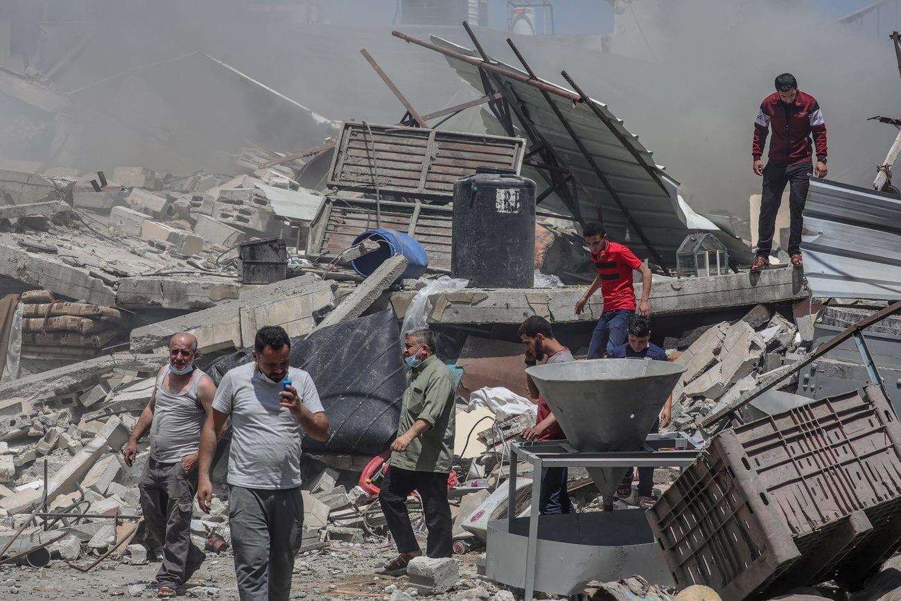 Un bâtiment détruit par les frappes aériennes à Gaza City. [EPA/Mohammed Saber - Keystone]