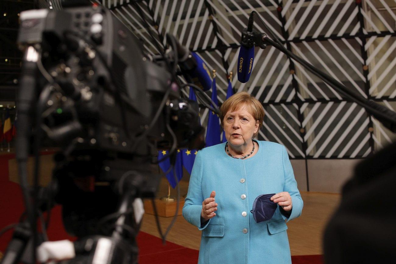 La chancelière allemande Angela Merkel voulait organiser une rencontre avec Vladimir Poutine. [Olivier Matthys - Keystone/AP]