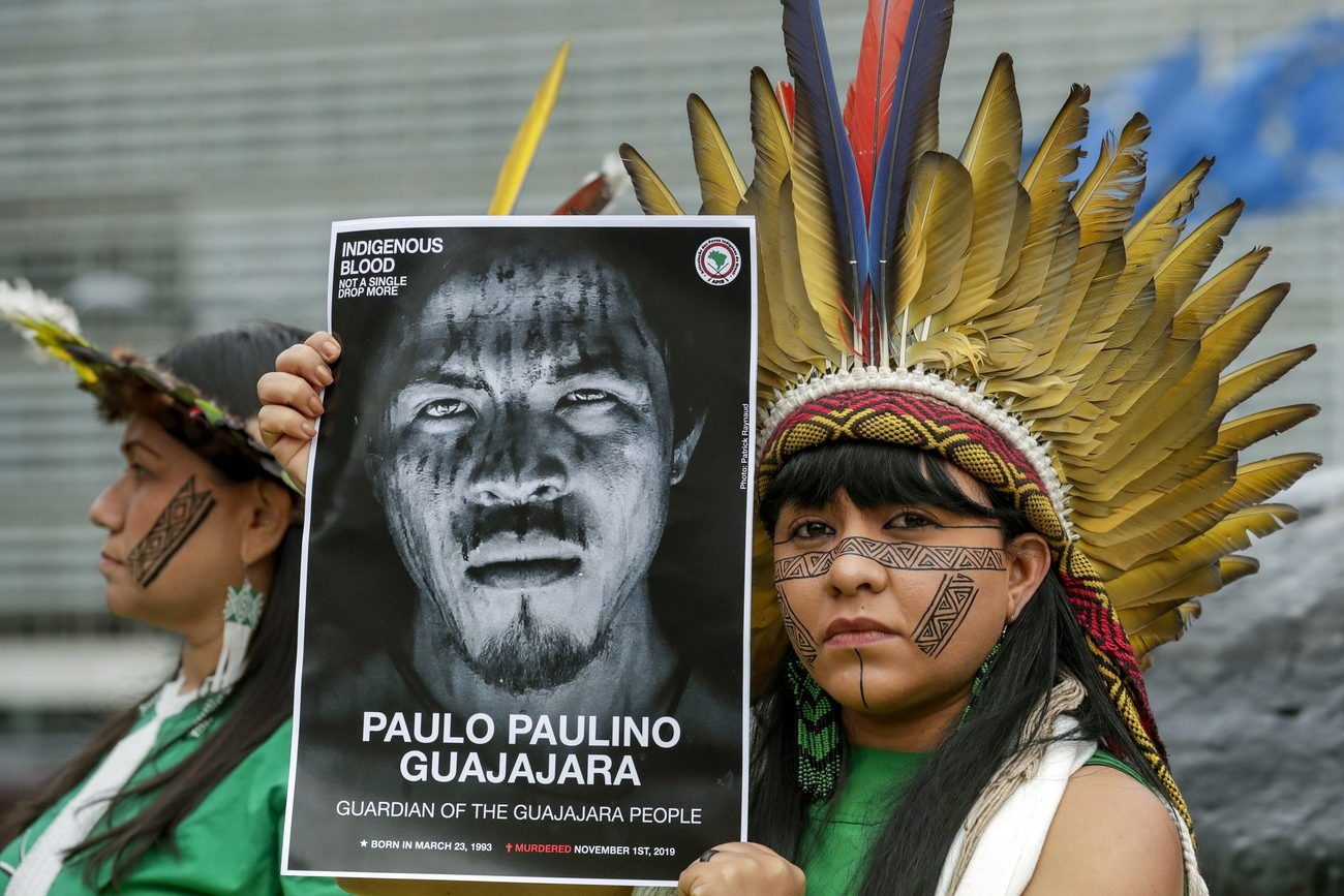 Manifestation après l'assassinat d'un défenseur de l'environnement tué par des exploitants forestiers illégaux dans la forêt amazonienne du Brésil en 2019. [EPA/OLIVIER HOSLET - Keystone]